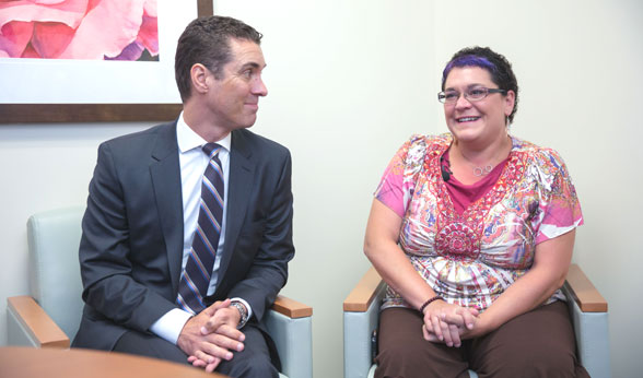 Patient Nichol Miller chats with Dr. Robert Doebele at CU Cancer Center