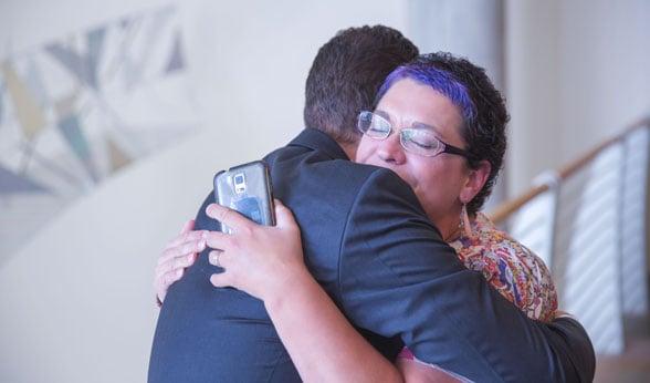 Cancer patient Nichol Miller embraces Dr. Robert Doebele at the CU Cancer Center