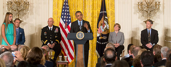 Comstock and President Barack Obama at the Healthy Kids and Safe Sports Concussion Summit