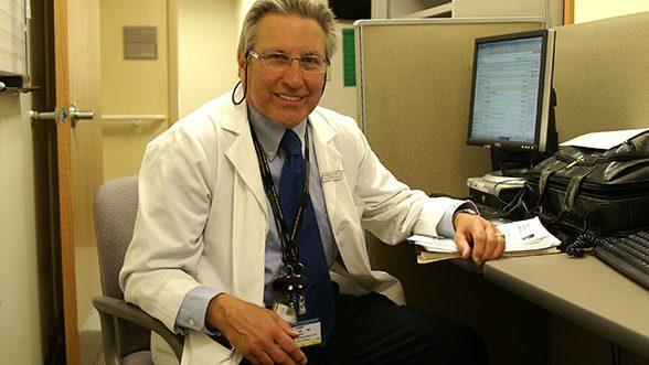 Robert Eckel at desk