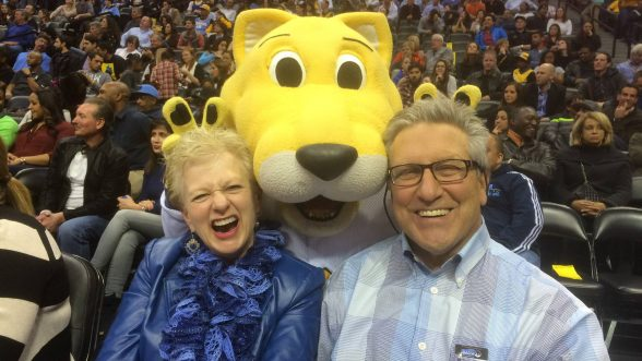 Eckel and wife at Nuggets game