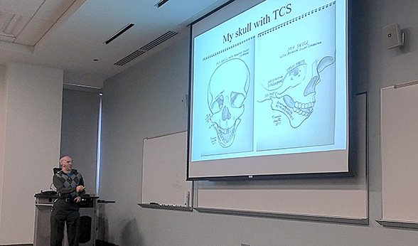 Francis Smith displays his skull drawings on a projector