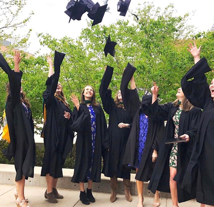Graduates toss caps 2019