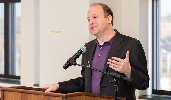Gov. Jared Polis at Strauss Health Sciences Library