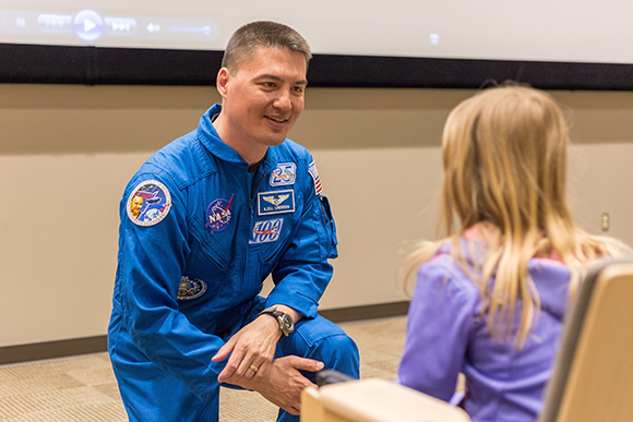 Kjell Lindgren gives child a NASA patch