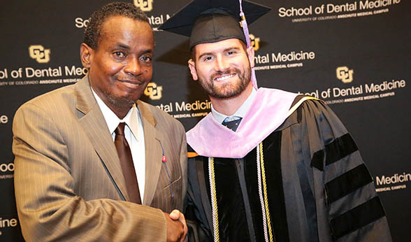 Willie Peterson and Bill Berguin at CU Dental School graduation